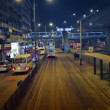 Night time traffic at a transit stop along an urban street in downtown Hong Kong. — Stock Video #77356472