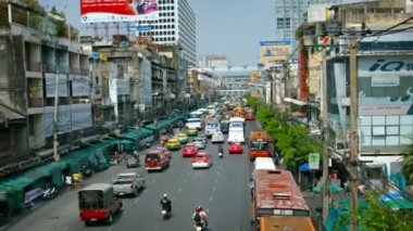 Traffic on a Typical Urban Street in Downtown Bangkok. Thailand — Wideo stockowe
