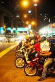 Motorcyclist on the road in Kuala Lumpur. — Stock Photo