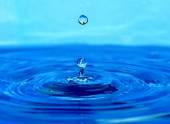 Splash of blue water — Stock Photo