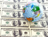 Dollars  and  globe — Foto Stock