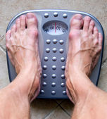 Feet on a scale — Stock Photo