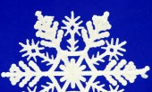 Snowflake on blue background — Stock Photo