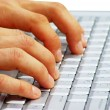 Hands typing on a laptop — Stock Photo #62782273