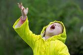 Young girl playing in rain — Stock Photo