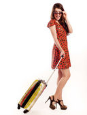 Full length of casual woman standing with travel suitcase - isol — Stock Photo