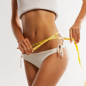 Woman measuring her waistline . Perfect Slim Body  — Stockfoto