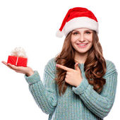 Christmas Santa hat isolated woman portrait hold christmas gift. Smiling happy girl on white background. — Stock Photo