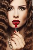 Applying lipstick — Стоковое фото