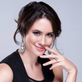 Portrait of beautiful brunette woman in black dress. Cosmetic Eyeshadows. Fashion photo — Stock Photo