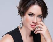 Portrait of beautiful brunette woman in black dress. Cosmetic Eyeshadows. Fashion photo — Stok fotoğraf