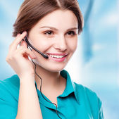 Portrait of happy smiling cheerful young support phone operator — Stock Photo
