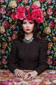 Portrait of a beautiful woman with flowers in her hair. Fashion photo  Pattern background — Stock Photo