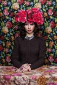 Portrait of a beautiful woman with flowers in her hair. Fashion photo ? Pattern background — Stock Photo