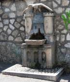 TIVOLI ITALY - AUGUST 26, 2014 : Drinking water fountain for people and animals — Stockfoto