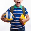 Happy schoolboy with backpack, ball and books isolated on white background — Stock Photo #55298951