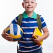 Happy schoolboy with backpack, ball and books isolated on white background — Stock Photo #55298953