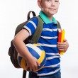 Happy schoolboy with backpack, ball and books isolated on white background — Stock Photo #55298977