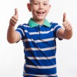 Portrait of happy boy showing thumbs up gesture, isolated over white background — Stock Photo #55299027