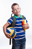 Happy schoolboy with backpack, ball and books isolated on white background — Stock fotografie