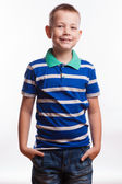 Young pretty boy posing at studio as a fashion model. Photo of preschooler 7 years old over white background — Stockfoto