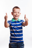 Portrait of happy boy showing thumbs up gesture, isolated over white background — Stock Photo