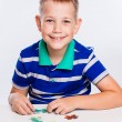 Cute little boy playing puzzles at the table — Stock Photo #55957237