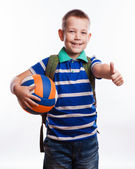 Happy schoolboy with backpack and soccer ball isolated on white  — Stock Photo