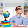 Cute schoolboy is writting isolated on a white background — Stock Photo #57577789