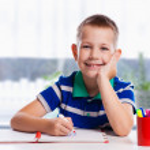 Cute schoolboy is writting — Stock Photo #57578259