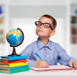 Cute schoolboy is writting isolated on a white background — Stock Photo #57578295