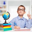 Cute schoolboy is writting isolated on a white background — Stock Photo #57578307