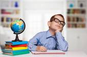 Tired Boy Sleeping on the School Desk on the white background — Stock Photo