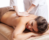 Masseur doing massage on woman body in the spa salon. Beauty treatment concept. — Stock Photo