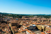 Florence, Italy. Cityscape with tiled roofs and Palazzo Vecchio in the distance — Stock Photo