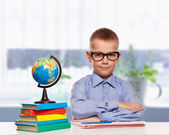 Cute schoolboy is writting — Fotografia Stock