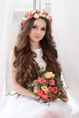 Gorgeous bride with flowers — Stock Photo