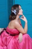 Young beautiful caucasian woman in gorgeous dress — Stock Photo