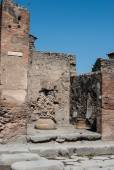 Pompeii is a ruined and partially buried Roman town-city near modern Naples in the Italian region of Campania, in the territory of the comune of Pompei.. — Stock Photo