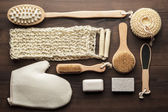 Some bath accessories on brown wooden background — Stock Photo