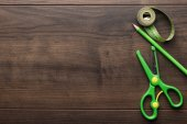 Green measuring tape, scissors and pencil — Stock Photo