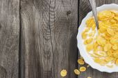 Bowl of cornflakes on the table — Stock Photo