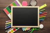 School supplies and blackboard — Foto Stock