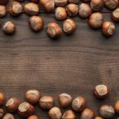 Hazelnuts on the brown wooden table — Stock Photo