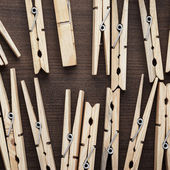 Wooden clothes pegs on the table — Stock Photo