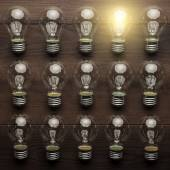 Glowing bulb uniqueness concept — Stock Photo
