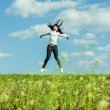Girl jumping in the field summer time — Stock Photo #69110583