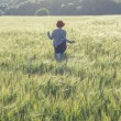 Girl running across green field in the morning — Foto de Stock   #69113997
