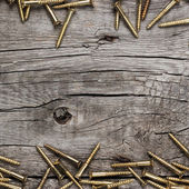 Yellow screws on the wooden table — Foto Stock