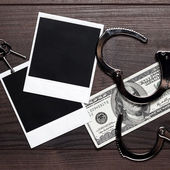 Handcuffs money and old photos detective concept — Stock Photo